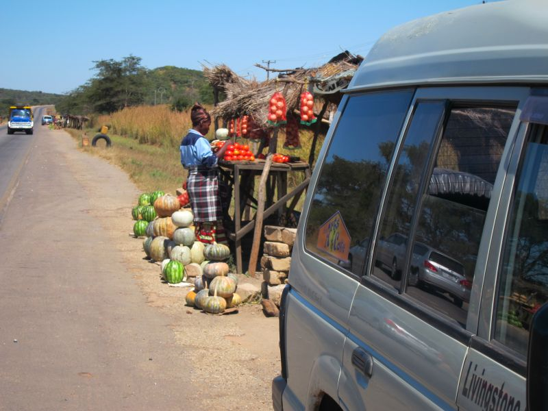 Buying a watermellon from one of many roadside vendors