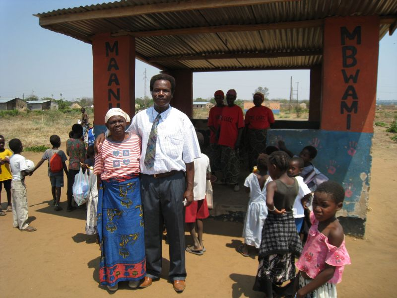Pastor Smoke Chewe with his mother who helps out at the school